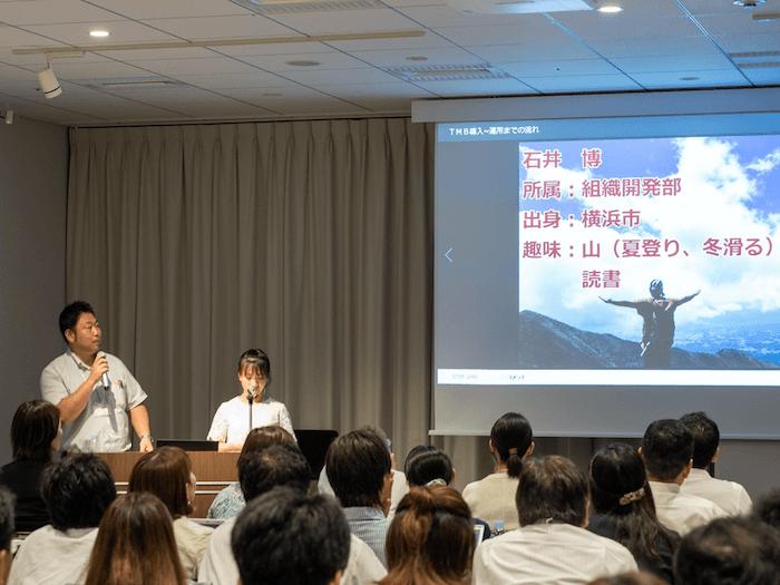画像:山好きな石井氏。発表内でも山に例えたジョークで会場が沸いていた